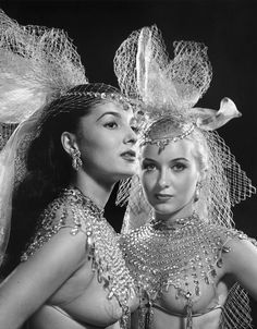 """Two showgirls of Mike Todd's revue called """"Michael Todd's Peep Show"""", running at the Winter Garden Theatre, from June 28, 1950 to February 24, 1951, for a total of 278 performances. Photo by Philippe Halsman, 1950."""