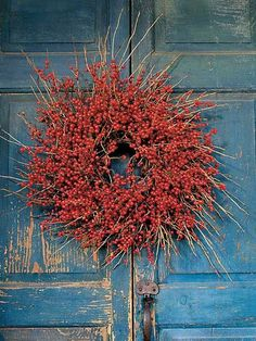 Winterberry glows with holiday color. This wreath weathers well indoors and out. For best results, gather winterberry after the first hard frost. The cold weather causes the leaves to drop from the branches, leaving only the brilliant berries. Outdoors, with cool temperatures, winterberry lasts about three months. Inside your home, hang it away from direct light and where it wont be disturbed. It will stay pretty for about a year. (Photo: Photo: Lynn Karlin; Stylist: ; Designer:)