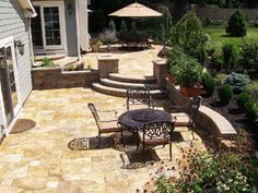 For this two level patio, a golden color was used and is lovely. Block walls were used for the retaining walls and blend well with the travertine.    Another option would have been to use travertine on the steps as the treads and use either natural stone (as the photo above shows) or mortared smaller sized travertine tiles on the risers.