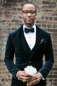 Stylish groom in a bow tie