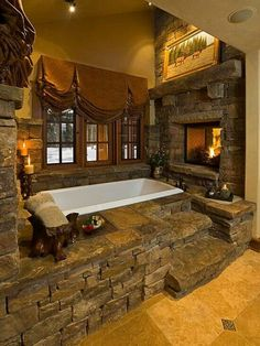 Seriously love this tub/fireplace and stonework!