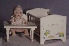 Ginnette with crib and teeter babe.