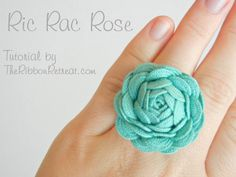 "great tutorial! i want to make one from that teensy ric rac i always see in the fabric store but never can justify the purchase. i think i'll dust it with some Martha glitter and a couple of the cutest little spun cotton mushrooms you've ever seen! oh how I've missed you, craftiness! ""Ric Rac Rose Tutorial - The Ribbon Retreat Blog"" Rac Rose, Hair Clips, Gift Ideas, Diy Gift, Rick Racks, Ric Rac, Handmade Gift, Ricrac, Rose Rings"