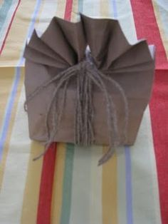 Brown paper sack used as a gift bag