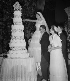 If you don't have to climb a ladder to cut your wedding cake, it's not tall enough!