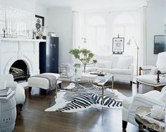 My current obsession..cowhide rugs... they add pattern and something a little unexpected to the room