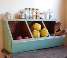 What an adorable and old school way to store fruits and veggies on the counter! I love it!