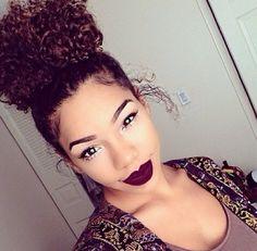 Naturally curly hair bun, makeup