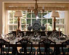 """""""Start traditionally English and layer in items from around the former empire's domain. This room starts with a traditional English base of heavy Chippendale dining chairs, then brings in the island influence with light"""""""