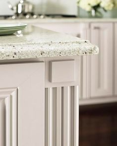 A gorgeous granite countertop looks even more impressive when accented with fielded rosettes and fluted fillers.