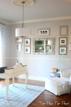 Soft gray home office. Love the silver wall gallery!