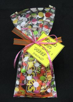 2 Reeses Pieces candy bags tied up with a tag that says:  Thank you for giving a piece of yourself!