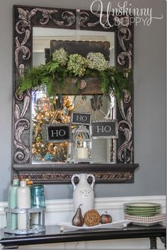 Vintage mailbox filled with evergreens and Ho Ho Ho on chalkboards