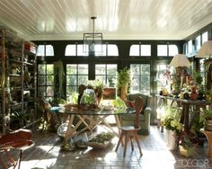 Seriously dreamy. Love the glossy beadboard ceiling, dark-framed french doors/transom windows, and brick floor. Erik Hyman & Max Mutchnick's Beverly Hills Tudor. Elle Decor, May 2012. They gotta have someone taking care of all those plants...