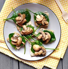 Plain Toasts Topped with A Pan Fried Mushrooms & Spinach Salad