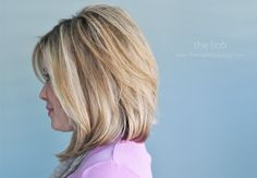 Soft graduated bob. It's not heavily graduated in the back, but there is some angle to the layering. Long angled bangs.