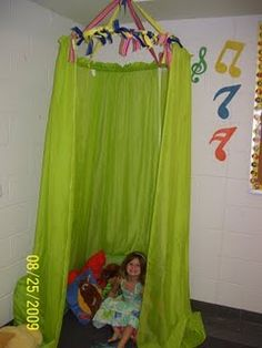 "reading center tent: hula hoop with curtains and ribbon - okay that will be much easier!  could use a valence across the front and sew matching ""doors"".  sew ribbon/strips to top of curtain to hang, and it will still let light in!"
