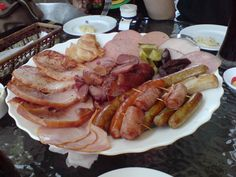 German hams, sausages and other cured meats, served with pickled gherkins and sauerkraut.