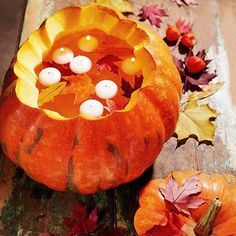 Float candles in a pumpkin.  Love it!