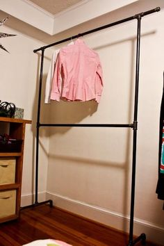 DIY clothing rack made from plumbing pipes. I so need this as we have a serious lack of closets in the house!