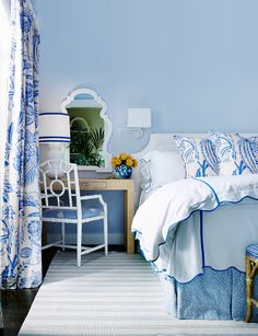 Blue and white bedroom - love the blue ribbon on the lampshade and fabric - Manuel Canovas's Lantana in blue and ivory
