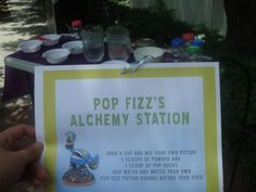 skylanders party station: Pop Fizz's Alchemy Station.  I got 4 different kinds of Kool-Aid and mixed the appropriate sugar in with the mix into separate bowls.  I also had various flavors of pop rocks in separate bowls as well.  The kids then picked a koolaid flavor (all a surprise) and put 2 scoops into a cup, and 1 scoop of pop rocks and then added water.  Once the water is added it shows the color and the pop rocks pop!  It was a fun surprise for them... I think it was their favorite :)