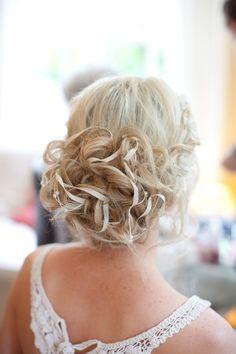 ribbon weaved through wedding hairstyle