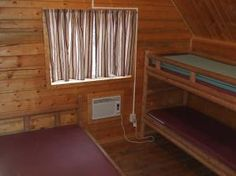 Hot Springs KOA - stay in one of our sleeping cabins that can sleep 4 people. These cabins have a full size bed and a set of bunk beds. There is AC, plus a ceiling fan, small desk, porch with porch swing, BBQ and picnic table