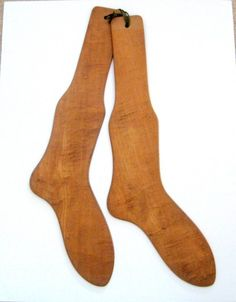 antique wooden sock form for drying socks.  etsy.