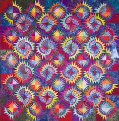 """""""Celebration of Colors"""" by the River City Quilters Guild.  2014 opportunity quilt. Inspired by Judy Neimeyer pattern '4th of July'."""