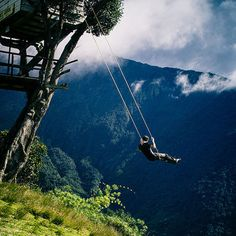 "Swing at the End of the World via atlasobscura: Deep in the Ecuadorian wilderness is a seismic monitoring station known as Casa del Arbol or ""The Treehouse"" because it is simply a small house built in a tree used for observing Mt. Tungurahua, the active volcano in the near distance. The simple swing lets you swing 2,600 m above sea level. #Swing #Ecuador"