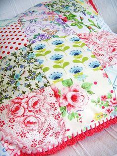 patchwork pillowcover with crochet edging, via Flickr.