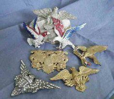 Patriotic eagles, potmetal, enamels, paste and paves.  Large stamped in center is Miriam Haskell patriot eagl, enamel