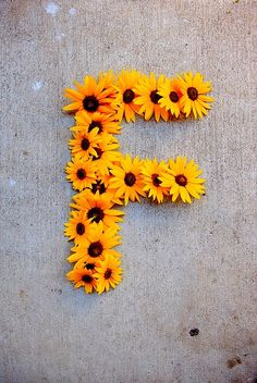 DIY fake sunflowers from michaels plus outline of letter