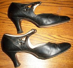1920s black buckle shoes. They are marked Johnson Stephens Shinkle, Fashion Plate, Celeste, Narrow Heel, Made Expressly for L & E bootery, Jackson Bay City.