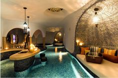 An indoor pool with a swim-up bar swimming pools, lounge areas, dream homes, basement, pool houses, beach club, cave, pool bar, river