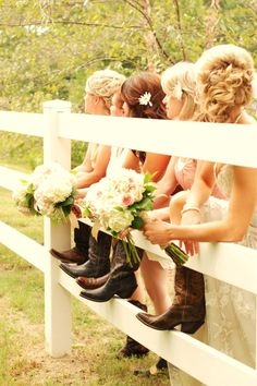 This is a great shot on all accounts - we love the brown cowboy boots, and we love that they're lined up by a white picket fence!