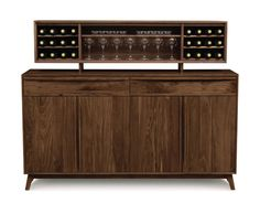 Catalina 2 Door, 5 Drawer Buffet shown with optional top shelf. Shown in Natural American Walnut wood.  Part of the Copeland Catalina Dining Collection.