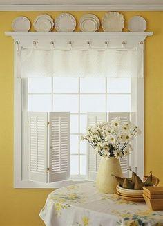 white plates and kitchen window treatments.