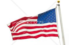american flag in wind - An American flag being held up by the winds