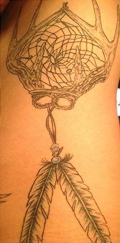 Deer antler dream catcher rib cage tattoo