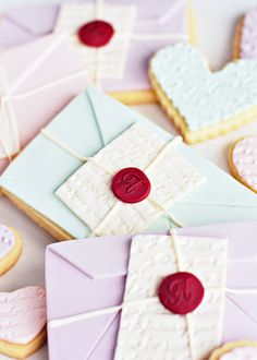 Cookie love letters Thinly rolled fondant (lemon or rose) over shortbread cookies (earl grey tea or rosemary or lavender)? Too much?