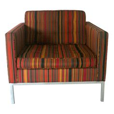 Striped Alexander Girard fabric lounge chair at