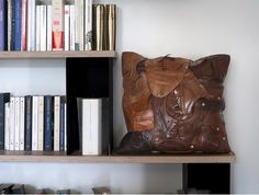 Only $1200 a pop! // French Designer Creates A Pillow From Old Leather Shoes - DesignTAXI.com