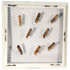 Mesh wire memo board with clothespin holders and a distressed frame.   Product: Memo boardConstruction Material: