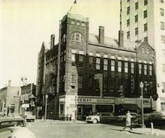View of the King Building in downtown Mansfield. Includes the Parkway Restaurant, Shumaker Drugs, and several old cars circa 1950. The King Building was erected in 1891.
