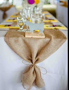 Tie the end of the burlap table runner with twine.