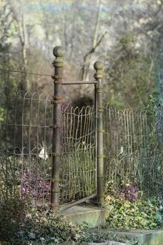 This could be their front fence except for the missing iron wagon wheel trellis supporting the Honeysuckle over the gate. This is beautiful.