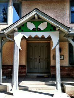 Some Masonite and a little paint and our house is a monster for Halloween this year!