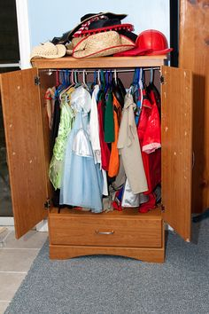 Closet for dress up clothes from small entertainment unit